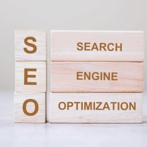 SEO (Search Engine Optimization) text wooden cube blocks on table background
